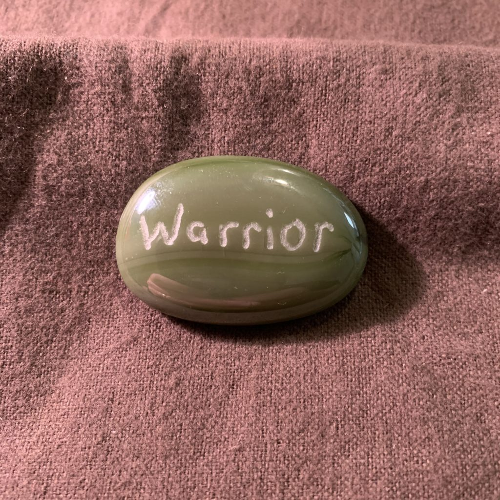 Green oval MyRockAndI worry stone with Warrior engraved on it